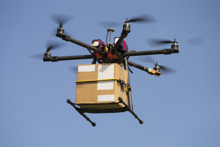 Drone carrying parcel