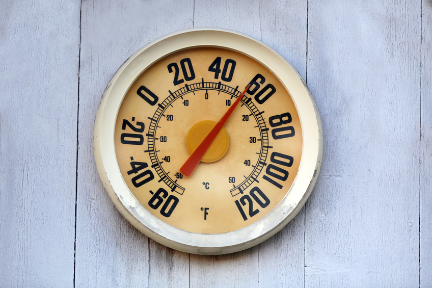 Old temperature gauge or thermometer.